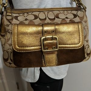 Like new metallic & suede buckle pkt coach bag